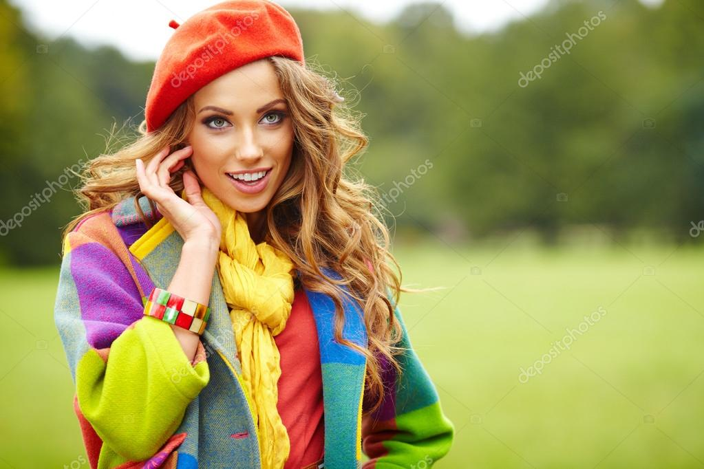 Fashion woman walking in autumn park