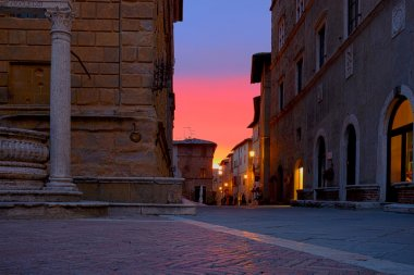 Sunset on the streets of Pienza stock vector