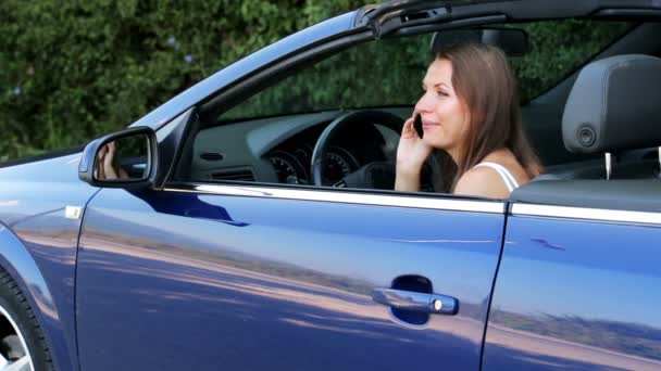 Cheerful girl sitting in a cabriolet