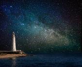 Fotografie Leuchtturm bei Nacht