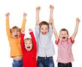 Fotografia bambini felici con le loro mani in alto