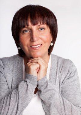 Portrait happy mature woman looking at camera stock vector