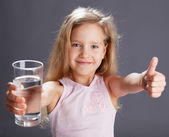 Fotografie Girl drinking water from glass