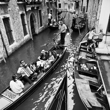 Life in Venice, Italy (travelling by gondolas with gondoliers),
