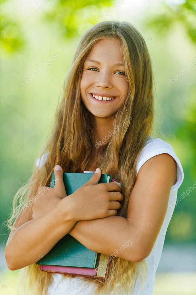 smiling beautiful teenage girl with books