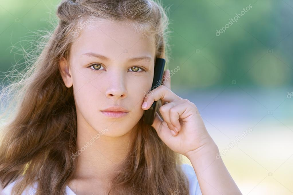 severe teenage girl talking on cell phone