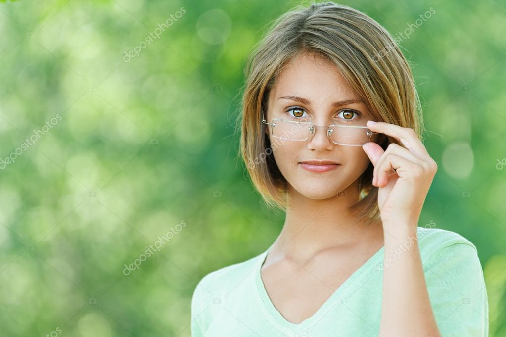 smiling beautiful young woman with glasses
