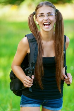 happy young woman with backpack