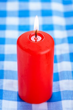 Big red candle burning