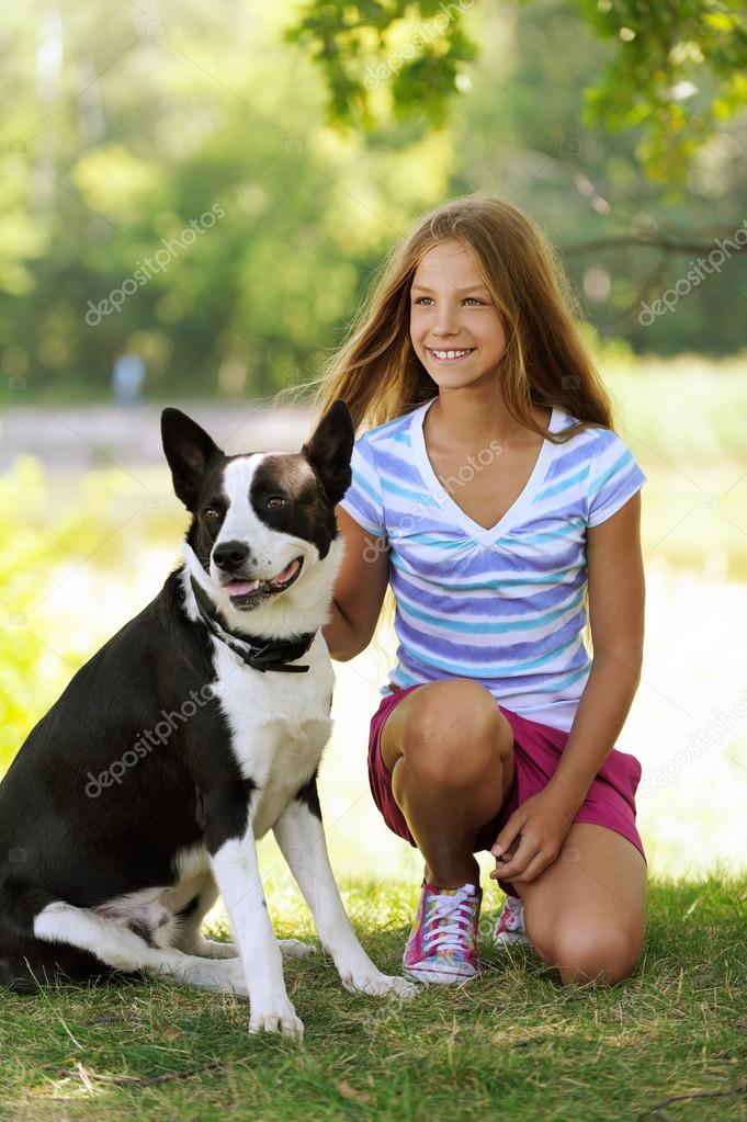 beautiful smiling girl with black dog