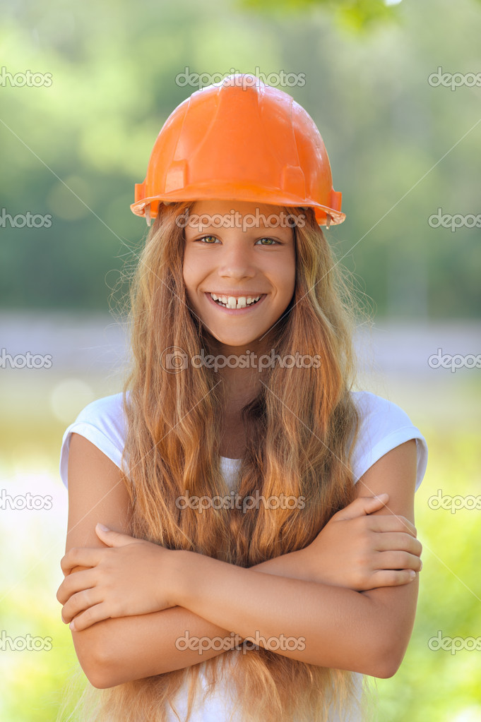 beautiful teenage girl in an orange helmet