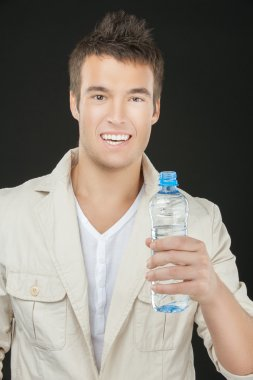 young man holding bottle of water
