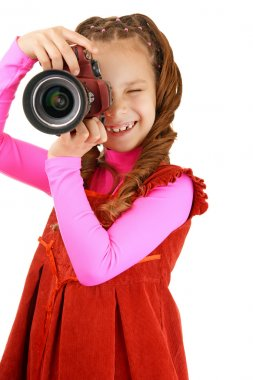 Smiling little girl in red dress with camera