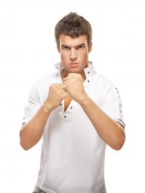 close-up portrait of young man holding fists