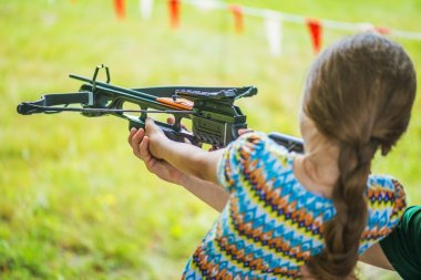 Little girl shooting crossbow
