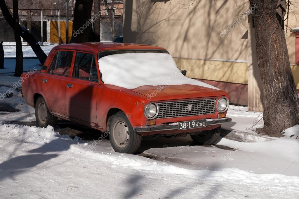 Old car with old registration number in Abakan – Stock Editorial ...
