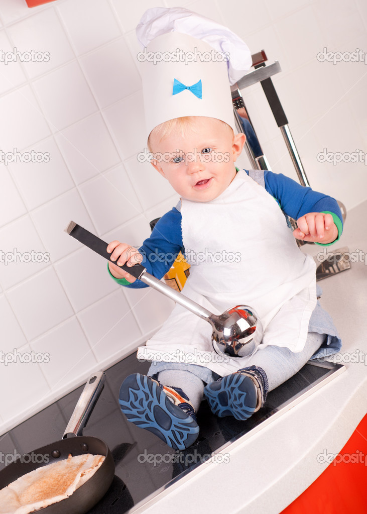 Little baby chef in the cook hat with metal ladle — Stock Photo ... 30101f47322d