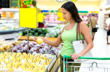 woman chooses pears in the store