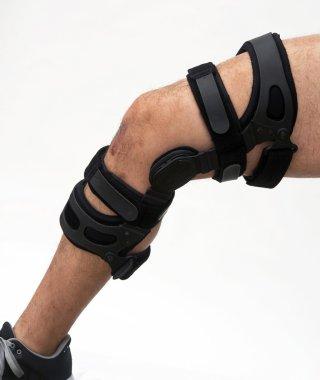 Knee brace for knee injury.