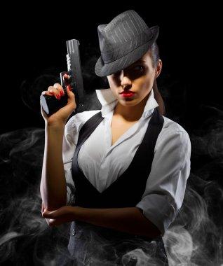 Dangerous and beautiful criminal girl with gun