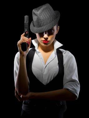 Dangerous young woman with gun