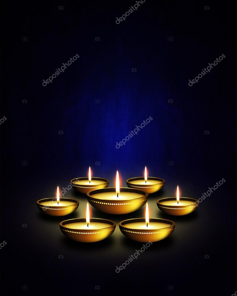 Oil Lamp With Diwali Greetings Over Dark Background Stock Photo