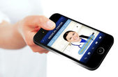 Hand holding mobile phone with medical center website