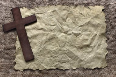 Wooden cross on old paper