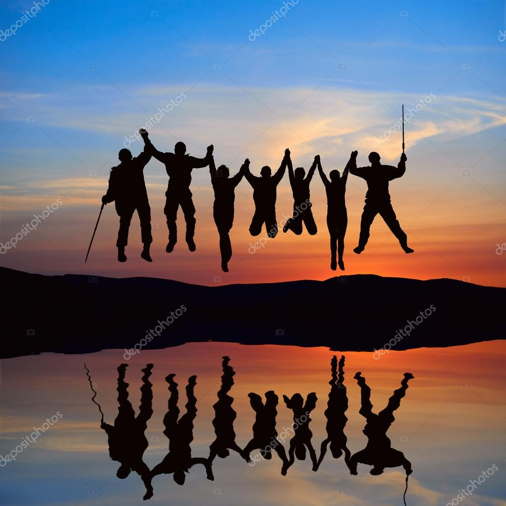 Silhouette of jumping friends