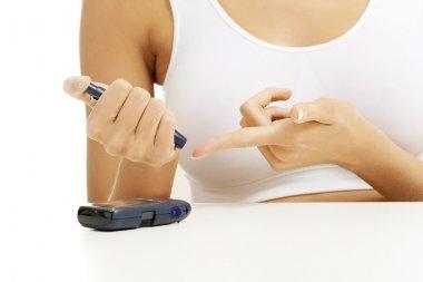 Diabetes patient measuring glucose level