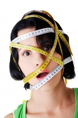 Beautiful young woman with measuring tape
