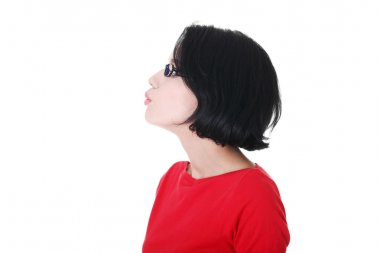 Profile of attractive woman in eyeglasses.