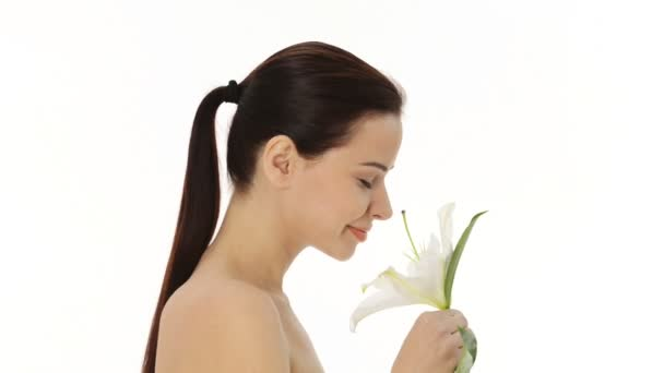 Beautiful woman holding lily flower.