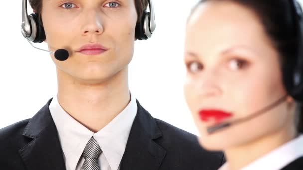 Attractive young people working in a call center . Over white background.