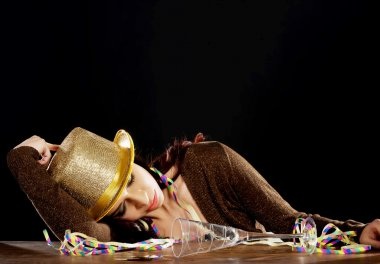 Young beautiful drunk woman sleeping on a table.