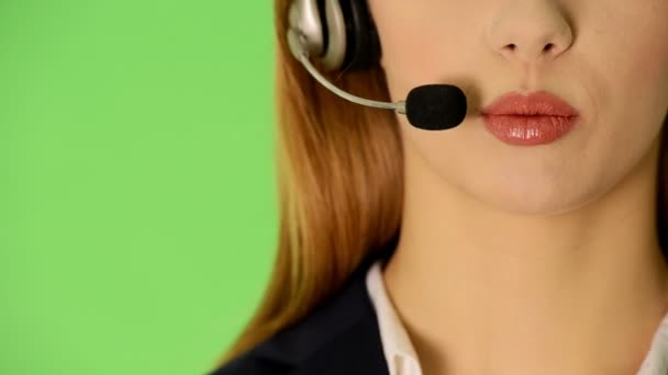Young business woman at call center.