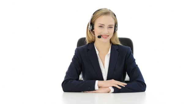 Young beautiful woman at call center showing OK