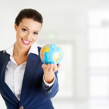 Young businesswomen with globe