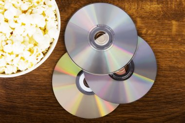 Picture of popcorn in a bowl and CDs.