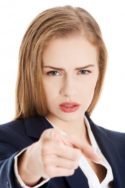 Young caucasian business woman showing warning gesture by hand.