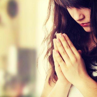 Closeup portrait of a young caucasian woman praying stock vector