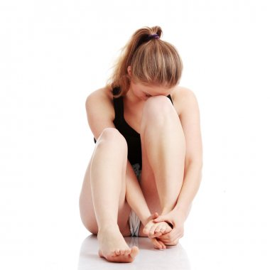 Woman experiencing leg cramp