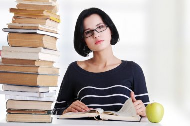 Young student woman studying at the desk