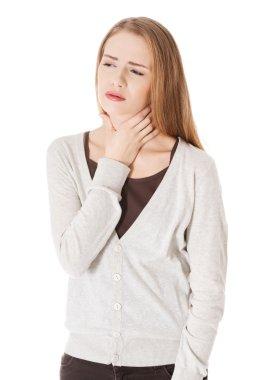Woman is having sore throat.