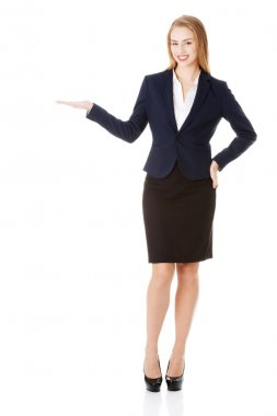 Business woman showing copy space on palms.