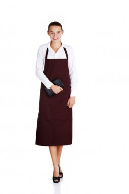 Attractive young waitress with notebook in hand.