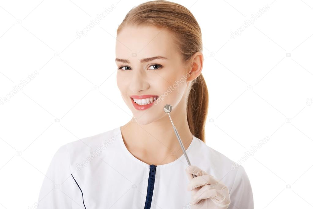 Young beautiful dentist woman with equipment.