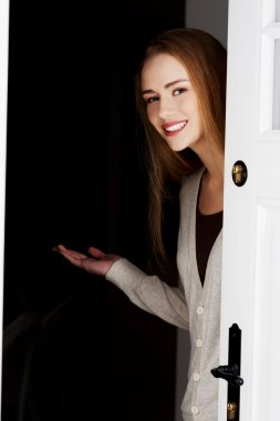 Woman inviting to come in.