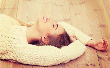 Woman lying on the floor.