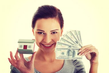 Woman with money and house .